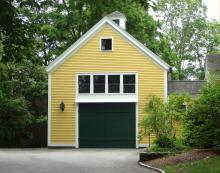 Bonus room above yellow garage with green garage door