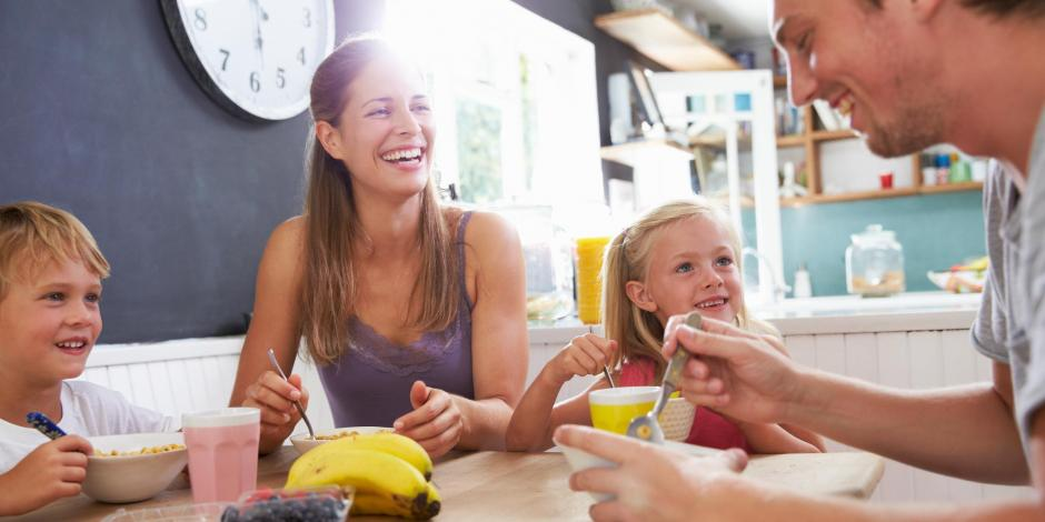 happy family eating breakfast