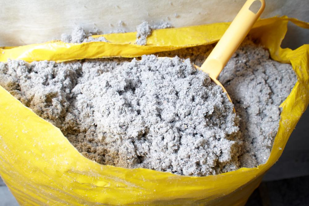 cellulose insulation in a bag with scoop